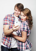 Smiling couple with smartphone, selfie and fun. — Stock Photo