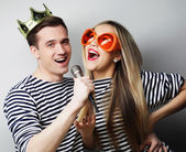 Beautiful young loving couple ready for party. — Stock Photo