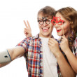 Smiling couple with smartphone, selfie and fun. — Stock Photo #77032325