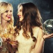 Two beautiful young women with wine glasses — Stock Photo #78517524