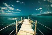 Wooden bridge - sea, summer. — Stock Photo
