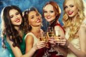 Party  girls clinking flutes with sparkling wine — Stock Photo