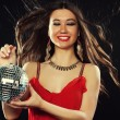 Young  woman in red dress keeping disco ball — Stok fotoğraf #79305242