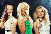 Girls clinking flutes with sparkling wine — Stock Photo