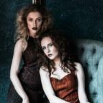Vogue style photo of two fashion ladies — Stock Photo #81387286