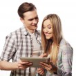 Happy young couple holding tablet pc computer — Stock Photo #82498094
