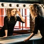 Beautiful fashion model woman posing near the mirror — Stock Photo #84484458