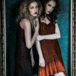Vogue style photo of two fashion ladies — Stock Photo #84611860