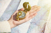 Compass in the hand — Stock Photo
