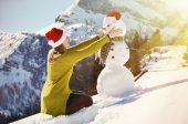 Girl with a snowman — Stock Photo