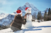 Snowman against Alpine panorama  — Stock Photo