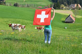 Girl holding the Swiss flag. Emmental, Switzerland — ストック写真