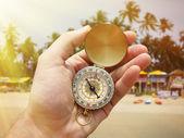 Compass in hand on Palolem beach — Stock Photo