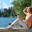 Girl with  wineglass at  Como lake — Stock Photo #71317449