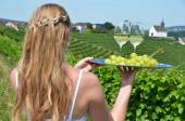 Girl holding wine and grapes — Stock Photo