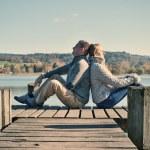 Couple on jetty at  lake. — Stock Photo #71886759