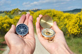 Man and woman holding compasses — Stock Photo