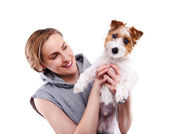 Happy woman with a dog - isolated over a white background — Stock Photo