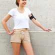 Young girl resting by wall. Joging outfit. — Stock Photo #75649459