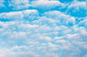 White cumulus clouds and a blue sky.  — Stock Photo