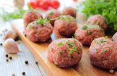 Meatballs with raw meat — Stock Photo