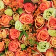 Orange and yellow roses in a bridal bouquet — Stock Photo #53389199