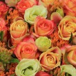 Orange and yellow roses in a bridal bouquet — Stock Photo #56101329
