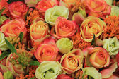 Orange and yellow roses in a bridal bouquet — Stock Photo