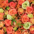 Orange and yellow roses in a bridal bouquet — Stock Photo #58244307