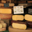 Cheese at a market stall — Stock Photo #60405823