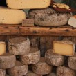 Cheese at a market stall — Stock Photo #60405903