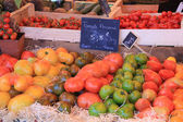 Tomatoes at a market stall — Stock Photo