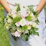 Bride holding bouquet — Stock Photo #72347083