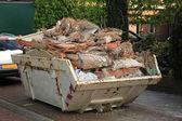 Loaded dumpster — Stock Photo
