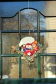 Christmas decoration on front door — Stock Photo