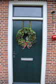 Front door with Christmas decorations — Stock Photo