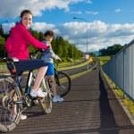 Teenage girl and boy riding bikes — Stock Photo #75237335