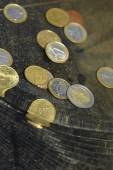 Coins under water — Stock Photo
