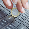Coin on laptop — Stock Photo #60046829