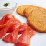 Potato pancakes with salmon — Stock Photo #60327087