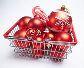 Christmas balls in shopping basket — Stock Photo