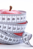 Measuring tape with apple — Stock Photo