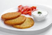 Potato pancakes with salmon — Stock Photo