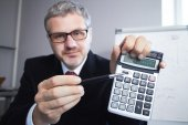 Portrait of Businessman with calculator — Stock Photo