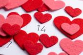 Paper hearts on calendar — Stock Photo