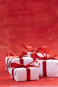 Gift boxes   on red — Stock Photo