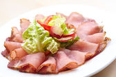 Sliced meat appetizer — Stock Photo