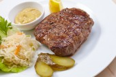 Steak with cabbage salad — Stock Photo
