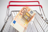 Euro bill in basket — Stock Photo