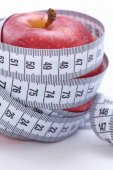 Measure tape and apple — Stock Photo